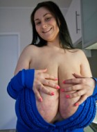 Deep d?collet? of this mature brunette can't restrain such massive tits